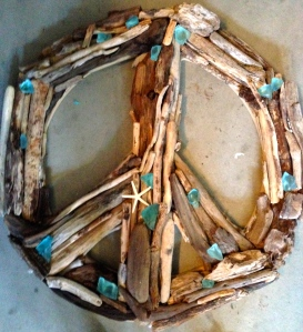 driftwood and seaglass peace sign