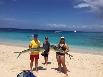 girls catch mahi mahi